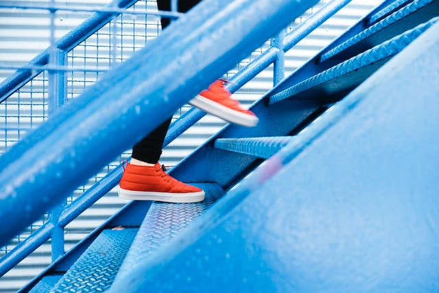 Trainers on Stairs Stepping Up in Your Career